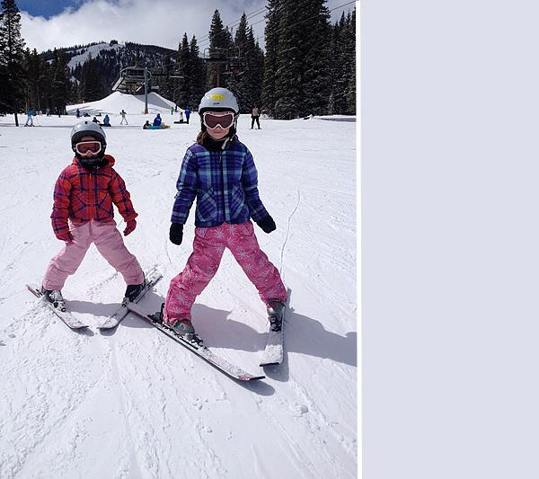 Little girls skiing