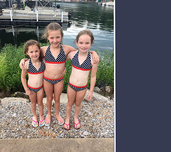 Cousins in matching swim suits