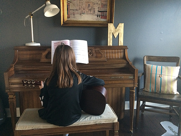 Caroline practicing guitar