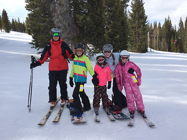 Dad skiing with the kids